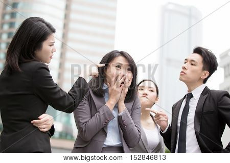 businesspeople bullying in office and someone unhappy, asian