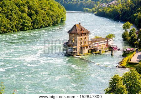 Landscape view on Rhein river with Worh water castle on the north of Switzerland