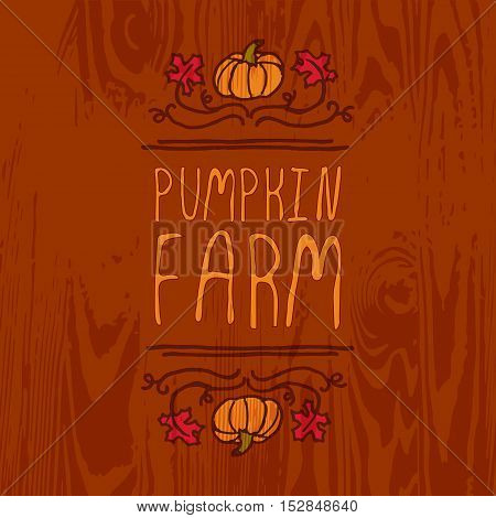 Hand-sketched typographic element with pumpkin, maple leaves and text on wooden background. Pumpkin farm