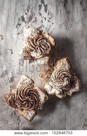 sweet cakes cupcakes on gray concrete background
