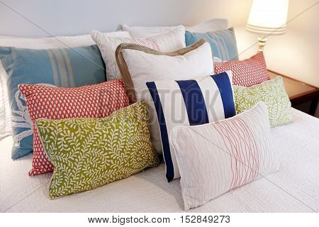 Close Up Of Neatly Arranged Colorful Pillows  In The Bedroom