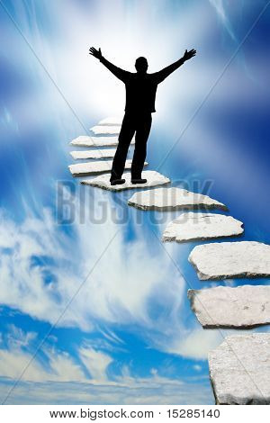 Male silhouette on a stone pathway leading to heaven