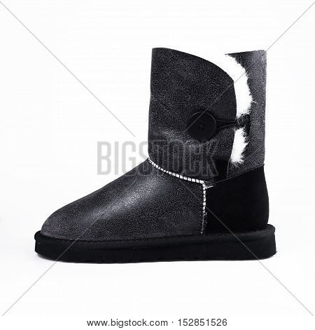stylish winter black shoes over white background