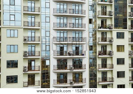 Multi-storey building skyscraper with balconies. Apartment house