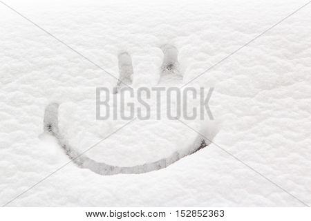 Smile drawn on snow. Smile on the white snow