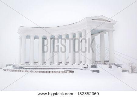 Colonnade in the snow. Winter scene. Ancient city architecture. Odessa Ukraine