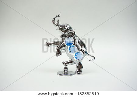 Metal Figurine Of An Elephant On A White Background, The Indian Elephant