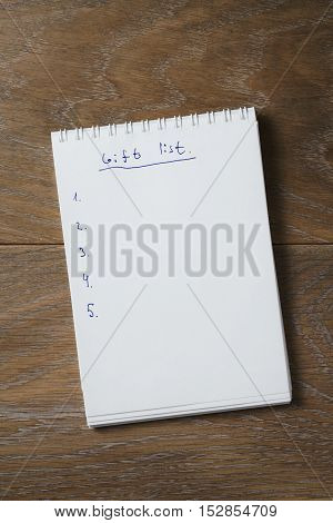 things to do list on notepad on wood table, blank notepad for your text