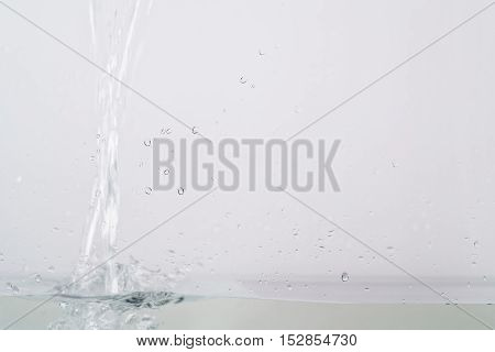 fresh water pouring in aquarium, focus on front glass