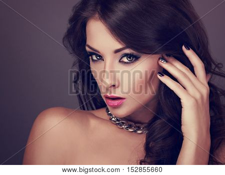 Beautiful Bright Evening Makeup Woman With Long Curly Hairstyle Looking Sexy In Fashion Necklace. To