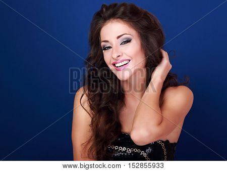 Beautiful Laughing Makeup Woman With Long Volume Hairdo On Bright Blue Background Looking Happy