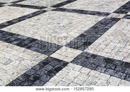 Decorative Sidewalk Pavement. Tiled Floor With Gray And Black Tiles, Double-crossed By A Diagonal St