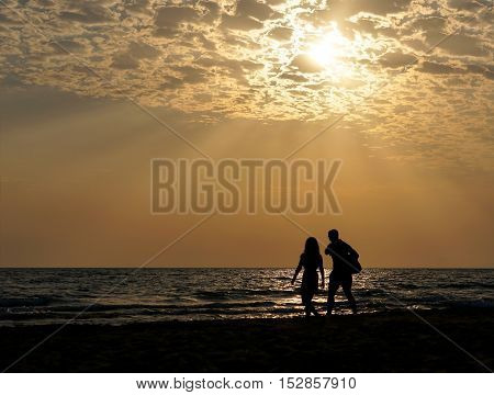 young couple on background of the sea and beautiful heavenly landscape