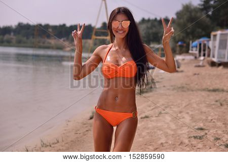 Picture Of Happy Smiling Woman Walking On The Beach.