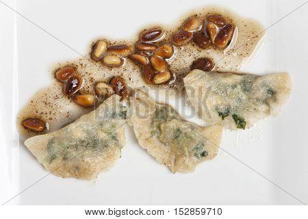 italian schlutzkrapfen filled pasta on a white plate