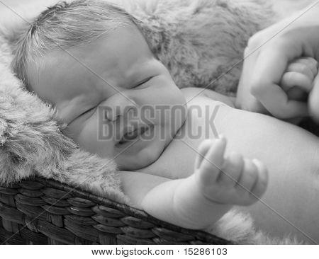 Crying newborn baby girl.