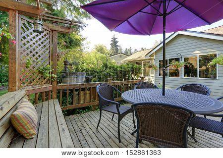 Backyard Patio Area With Outdoor Wicker Furniture
