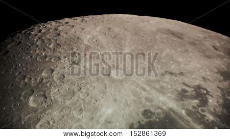 Lunar crater surface through a telescope at night.