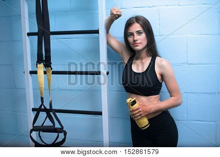 Beautiful Young Woman With Long Straight Brunet Hair Wearing In Blue Shirt Is Doing Exercises With T