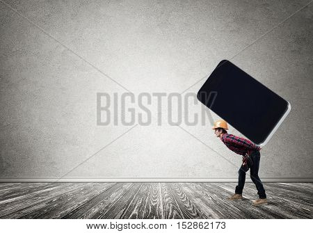 Man engineer carrying on back big smartphone