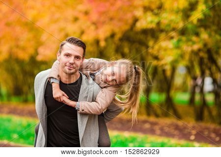 Happy family have fun on beautiful autumn day