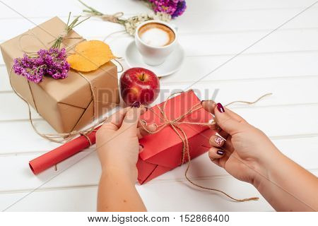 Making and decorate handmade gift box on a autumn background.