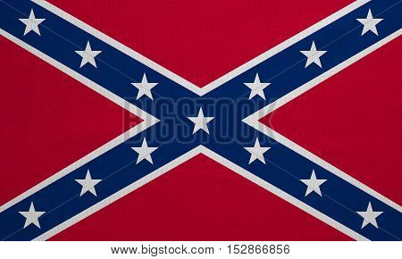 Historical national flag of the Confederate States of America. Known as Confederate Battle Rebel Southern Cross Dixie flag. Patriotic symbol banner. Flag of the CSA fabric texture illustration
