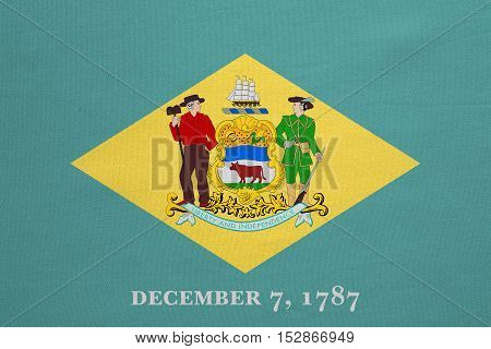 Flag of the US state of Delaware. American patriotic element. USA banner. United States of America symbol. Delawarean official flag real detailed fabric texture illustration. Accurate size colors