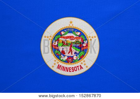 Flag of the US state of Minnesota. American patriotic element. USA banner. United States of America symbol. Minnesotan official flag real detailed fabric texture illustration. Accurate size colors