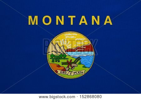 Flag of the US state of Montana. American patriotic element. USA banner. United States of America symbol. Montanan official flag with real detailed fabric texture illustration. Accurate size colors
