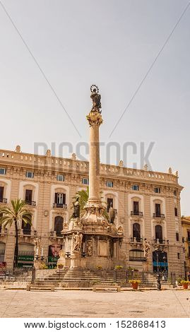 PALERMO ITALY - SEPTEMBER 6 2015: The obelisk-like Colonna dell Immacolata or Immaculate Virgin in the square San Domenico in Palermo Sicily Italy.