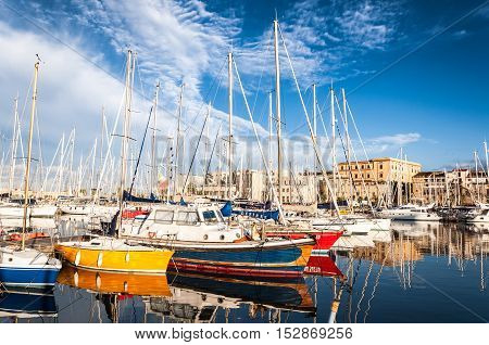 PALERMO ITALY - SEPTEMBER 9 2015: Boats and yachts parked in La Cala bay old port in Palermo Sicily Italy.
