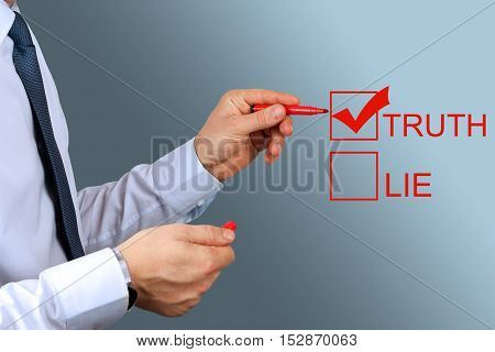 Businesswoman making one's choice between truth or lie