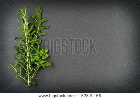 Rosemary, Rocket And Chervil Herbs On Slate