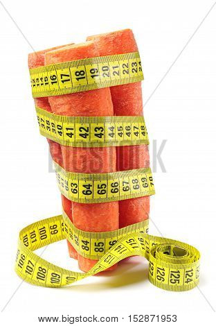 Carrots with measuring tape on white background