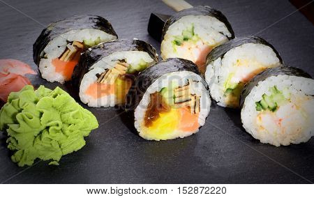 Fresh Sushi Rolls On Slate Plate