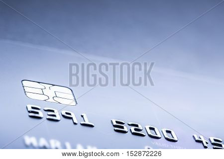 Credit or debit payment card. Macro shot credit card with euro banknotes.