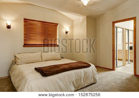 Light Tones Bedroom Interior With Carpet Floor