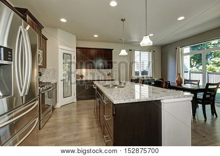 Large Kitchen Island In Modern Open Plan Kitchen
