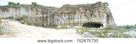 Jaddih white limestone hill, pote mountain in Bangkalan, Madura Island, Indonesia. covered with grass field