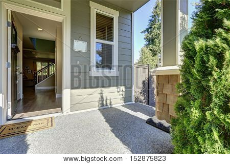 Entrance Porch With Opened Door On A Sunny Day