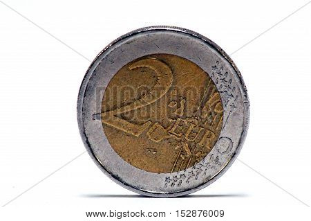 Two-euro coin of euro put on the custard tart with a white bottom.
