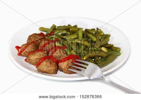 Swedish meatballs with green beans on white background