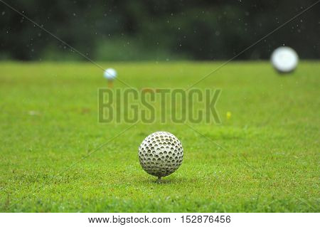 Dirty Golf Ball On The Field
