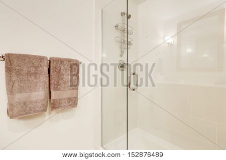 Close Up Of Glass Shower Cabin In White Clean Bathroom