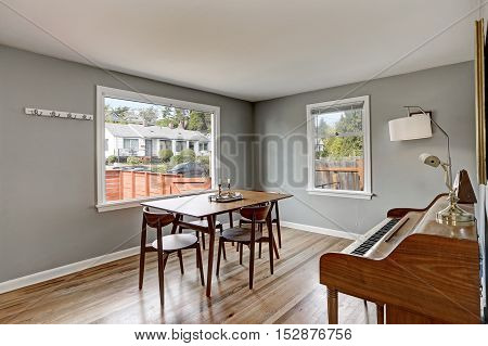 Gray Dining Room Interior With Piano