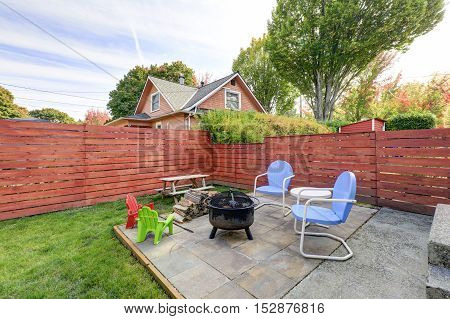 Fenced Back Yard With Patio Area And Barbecue Grill