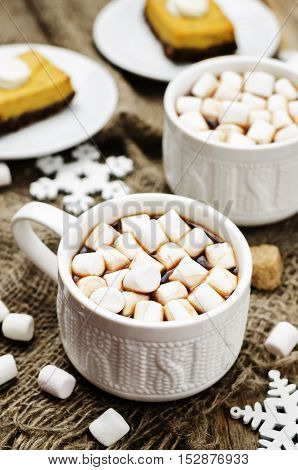 hot cocoa with mini marshmallows on wood background