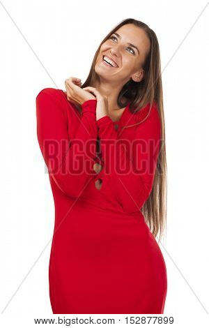 Young beautiful brunette woman in red dress, isolated on white background