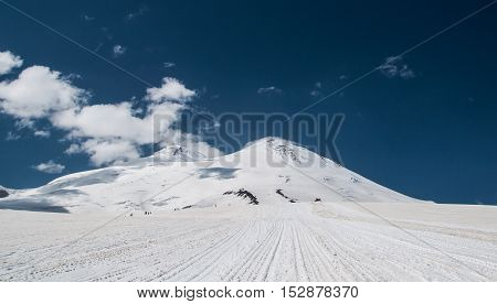 Mount Elbrus is a dormant volcano located in the northern Caucasus mountains in Kabardino-Balkaria Russia. Elbrus is peak is the highest in the Caucasus Mountains in Russia and in Europe.
